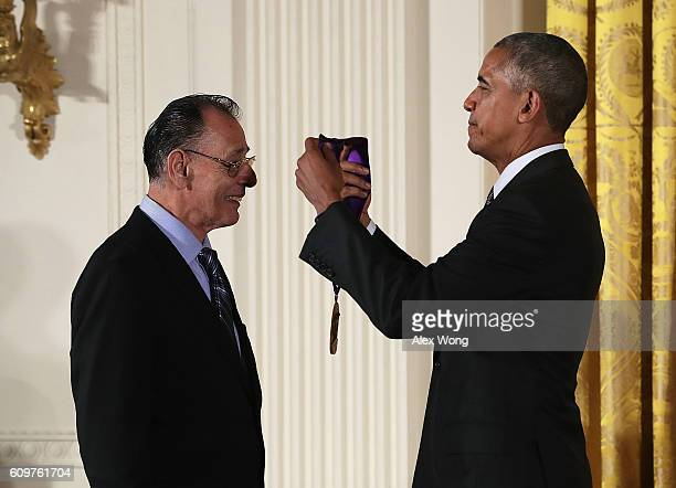 S President Barack Obama presents the National Medal of Arts to musician Santiago Jimenez Jr during an East Room ceremony at the White House...