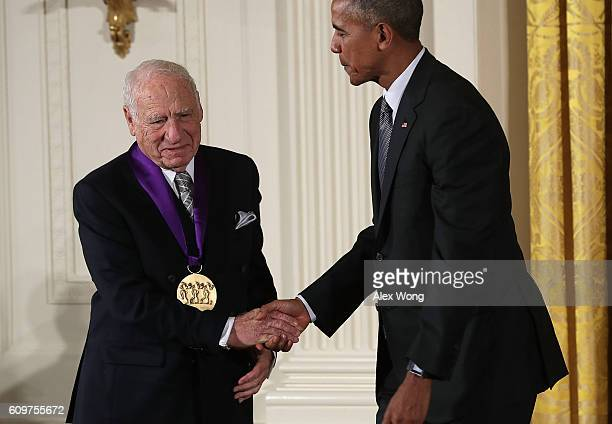 S President Barack Obama presents the National Medal of Arts to comedian Mel Brooks during an East Room ceremony at the White House September 22 2016...