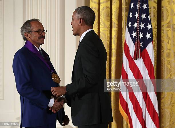 S President Barack Obama presents the National Medal of Arts to painter Jack Whitten during an East Room ceremony at the White House September 22...
