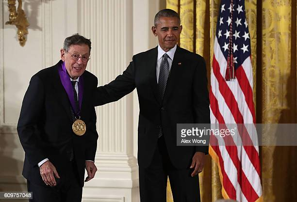 S President Barack Obama presents the National Medal of Arts to composer Philip Glass during an East Room ceremony at the White House September 22...