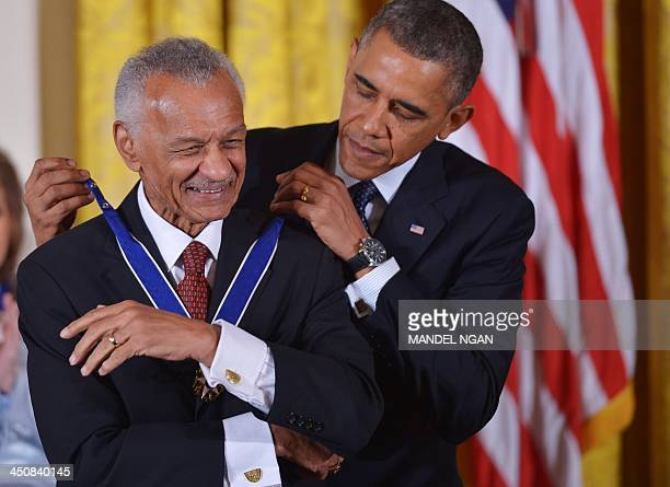 President Barack Obama presents the Presidential Medal of Freedom to minister/author, Cordy Tindell Vivian during a ceremony in the East Room of the...