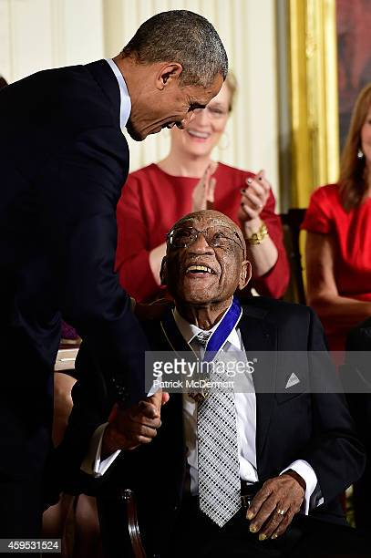 S President Barack Obama presents the Presidential Medal of Freedom to former professional golfer Dr Charles L Charlie Sifford during an East Room...