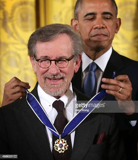 S President Barack Obama presents the Presidential Medal of Freedom to filmmaker Steven Spielberg during an East Room ceremony November 24 2015 at...