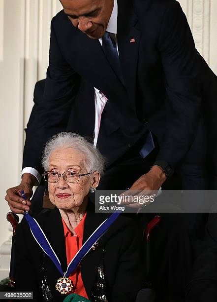 S President Barack Obama presents the Presidential Medal of Freedom to former NASA mathematician Katherine G Johnson during an East Room ceremony...