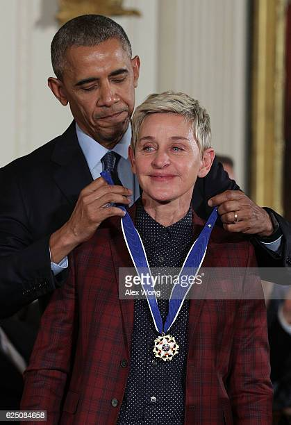S President Barack Obama presents the Presidential Medal of Freedom to comedian and talk show host Ellen DeGeneres during an East Room ceremony at...