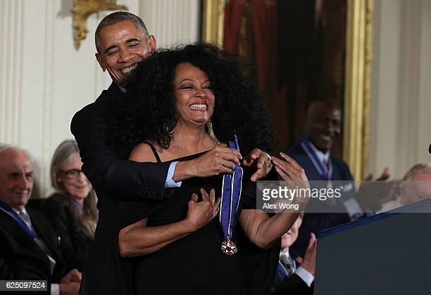S President Barack Obama presents the Presidential Medal of Freedom to Diana Ross during an East Room ceremony at the White House November 22 2016 in...