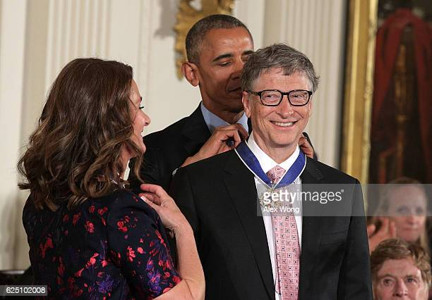 S President Barack Obama presents the Presidential Medal of Freedom to Bill and Melinda Gates during an East Room ceremony at the White House...