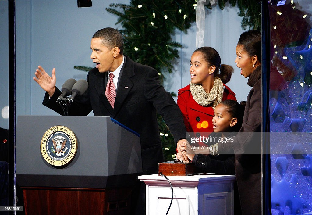 U.S. President Barack Obama presses the button to light up the National Christmas Tree with daughters  sc 1 st  Getty Images & Obamas Take Part In Lighting Ceremony For National Christmas Tree ... azcodes.com