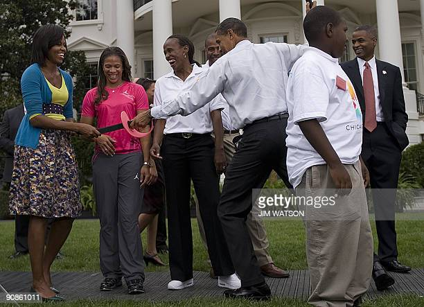 US President Barack Obama pretends to fence with First Lady Michelle Obama during an event on Olympics Paralympics and youth sport on the South Lawn...