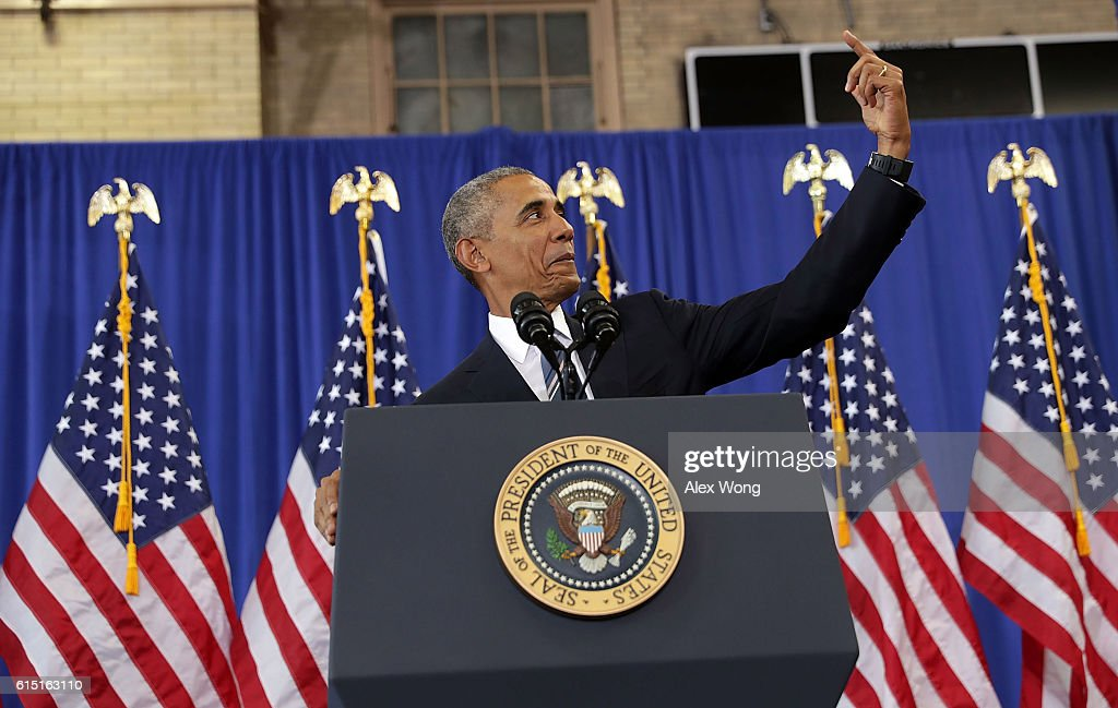 U.S. President Barack Obama pretends to take a selfie during an event at Benjamin Banneker Academic High School on October 17, 2016 in Washington, DC. President Obama delivered remarks to highlight the progress he has made to improve education across the country including a rise in high school graduation rates.