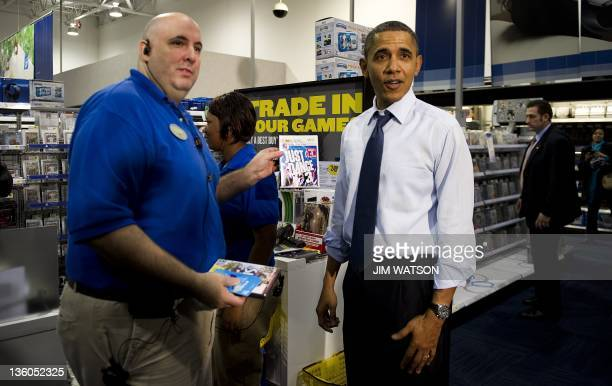 US President Barack Obama purchases Just Dance 3 for the Wii gaming console while shopping at Best Buy in Alexandria Virginia December 21 2011 AFP...