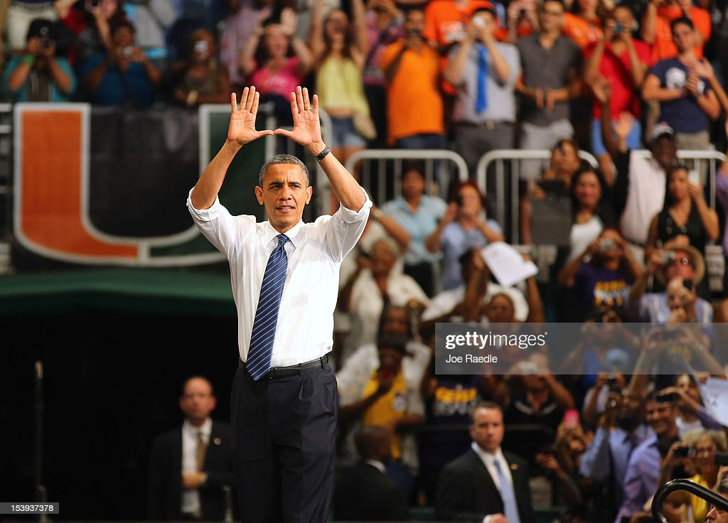 U.S. President Barack Obama puts his hands in the shape of a U, which is the University of Miami symbol, before speaking during a campaign rally at the BankUnited Center at the University of Miami on October 11, 2012 in Miami, Florida. President Obama continues to campaign across the nation with less than a month to go until the election.