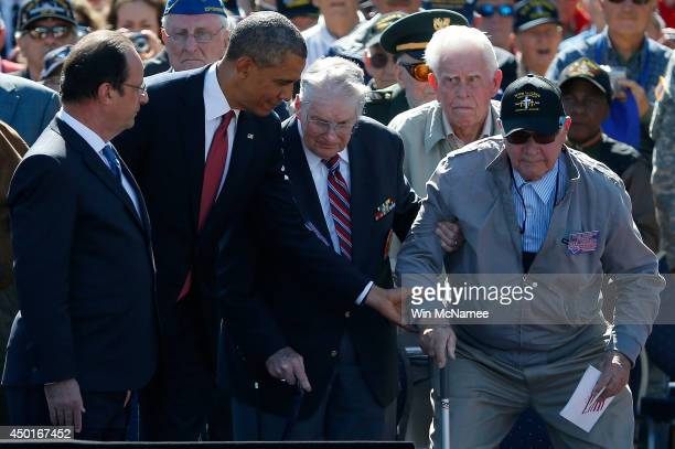S President Barack Obama reaches out to assist a WWII veteran during a ceremony at the Normandy American Cemetery on the 70th anniversary of DDay...