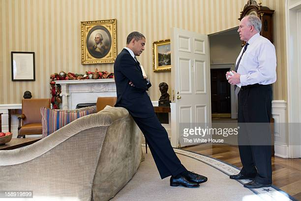 US President Barack Obama reacts as John Brennan briefs him on the details of the shootings at Sandy Hook Elementary School in Newtown Conn on...