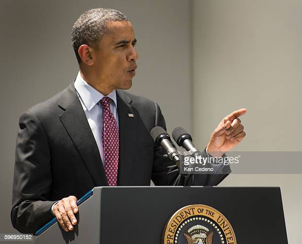 President Barack Obama reacts to being interrupted with questions from Neil Munro of the Daily Caller while Obama spoke about the Department of...