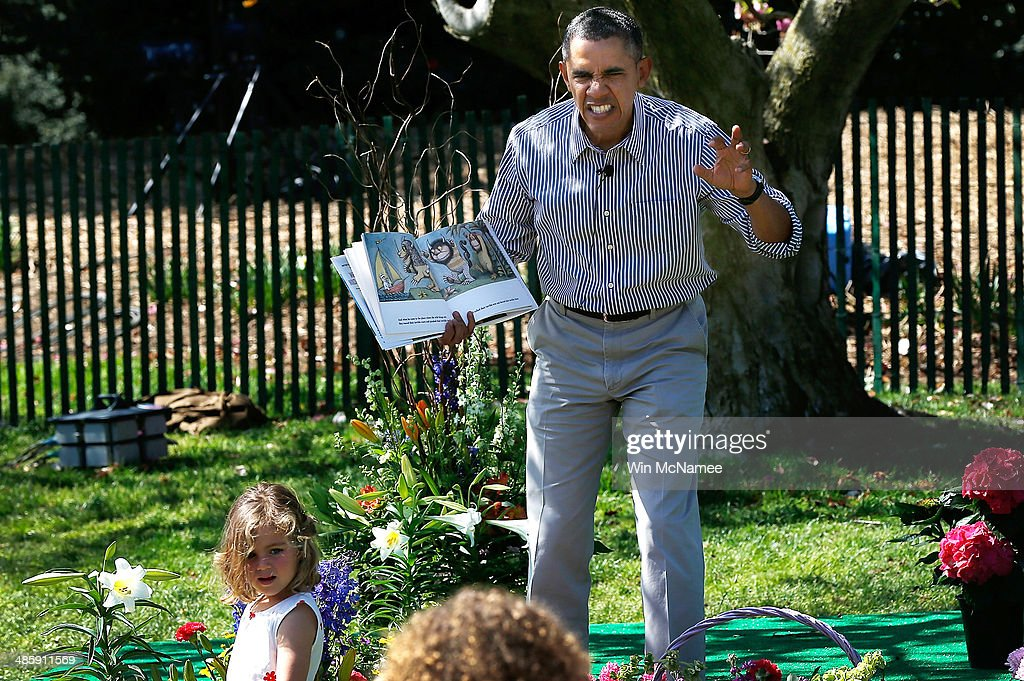 U.S. President Barack Obama read to children from the book 'Where the Wild Things Are' during the annual White House Easter Egg Roll on the South Lawn April 21, 2014 in Washington, DC. President Obama and the first lady hosted thousands of children for the annual White House event dating back to 1876 that features live music, sports courts, cooking stations, storytelling, as well as the Easter egg roll this year.