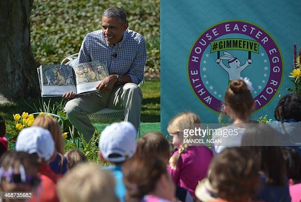 US President Barack Obama reads 'Where the Wild Things Are' by Maurice Sendak during the annual Easter egg roll on the South Lawn of the White House...