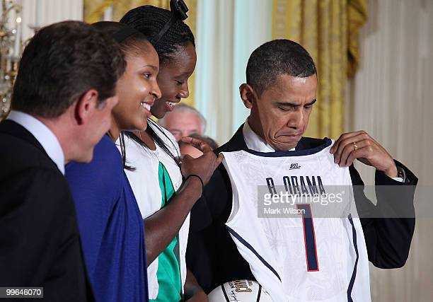 S President Barack Obama receives a jersey from the NCAA champion University of Connecticut women�s basketball team in the East Room at the White...