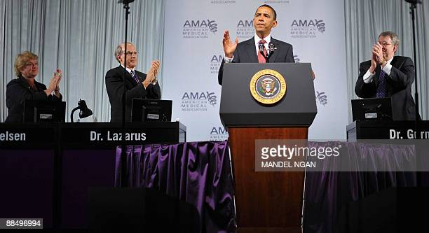 US President Barack Obama receives applause as he speaks on June 15 2009 during an address to the American Medical Association�s annual conference at...