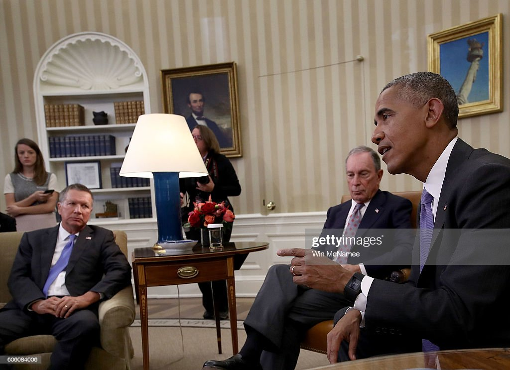 U.S. President Barack Obama responds to a question about Republican presidential candidate Donald Trump questioning Obama's place of birth during a meeting with business, government, and national security leaders in the Oval Office of the White House September 16, 2016 in Washington, DC. Obama met with the business, government, and national security leaders to discuss the Trans-Pacific Partnership. Also pictured are Ohio Governor John Kasich (L), and former New York City Mayor Michael Bloomberg (C).