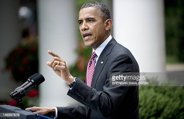 President Barack Obama responds to a shouted question by Neil Munro, a reporter with the online publication The Daily Caller, during an event in the...