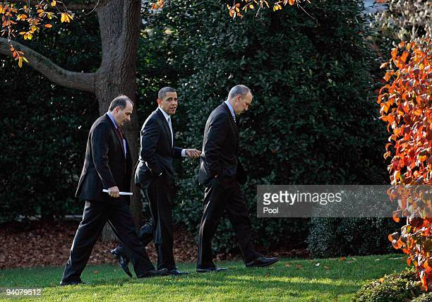 US President Barack Obama returns to the Oval Office with Senior Advisor David Axelrod and Assistant to the President for Legislative Affairs Phil...