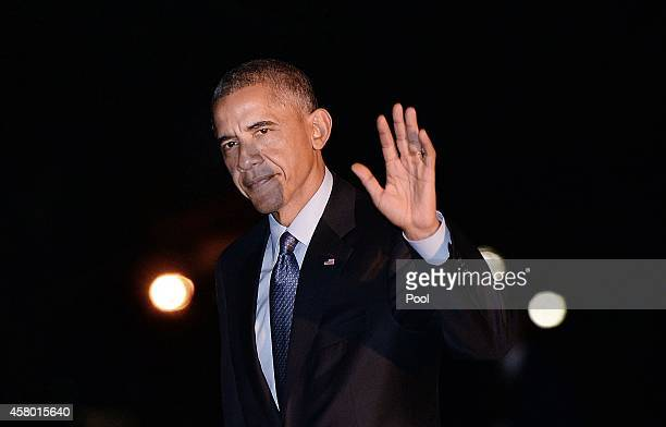 President Barack Obama returns to the White House after a campaign rally with Democrats in Wisconsin October 28, 2014 in Washington, DC. Voters go to...