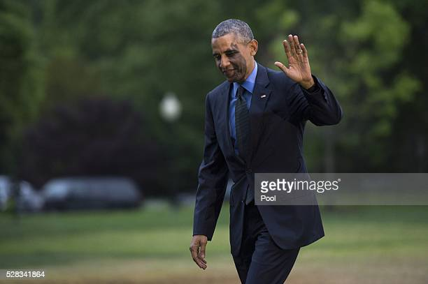 S President Barack Obama returns to the White House following a day trip to Flint Michigan on the South Lawn of the White House on May 4 2016 in...