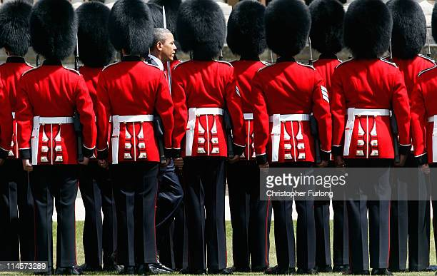 President Barack Obama reviews the honour guard during a ceremonial welcome in the garden of Buckingham Palace on May 24 2011 in London England The...