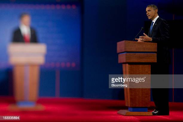 US President Barack Obama right and Mitt Romney Republican presidential candidate participate in a presidential debate in this photo taken with a...