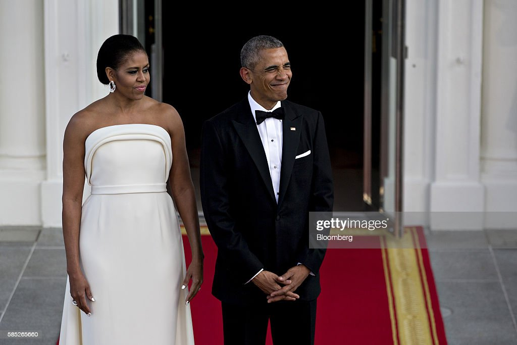U.S. President Barack Obama, right, and U.S. First Lady Michelle Obama wait during an arrival for Singapore Prime Minister Lee Hsien Loong, not pictured, to the State Dinner on the North Portico of the White House in Washington, D.C., U.S., on Tuesday, Aug. 2, 2016. The occasion marks first official visit by a Singapore prime minister since 1985. Photographer: Andrew Harrer/Bloomberg via Getty Images