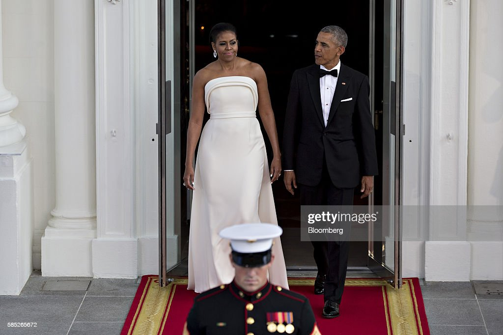 U.S. President Barack Obama, right, and U.S. First Lady Michelle Obama walk out of the White House during an arrival for Singapore Prime Minister Lee Hsien Loong, not pictured, to the State Dinner on the North Portico of the White House in Washington, D.C., U.S., on Tuesday, Aug. 2, 2016. The occasion marks first official visit by a Singapore prime minister since 1985. Photographer: Andrew Harrer/Bloomberg via Getty Images