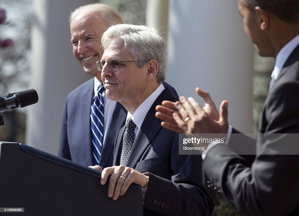 U.S. President Barack Obama, right, and Vice President Joseph 'Joe' Biden, left, look on during remarks by Merrick Garland, chief judge of the U.S. Court of Appeals for the District of Columbia Circuit, following the announcement of his nomination for the Supreme Court in the Rose Garden of the White House in Washington, D.C., U.S., on Wednesday, March 16, 2016. The nomination escalates a battle that will dominate the final 10 months of Obamas presidency, as the White House is locked in an unprecedented dispute with Senate Republican leaders who have pledged to ignore the presidents choice. Photographer: Joshua Roberts/Bloomberg via Getty Images