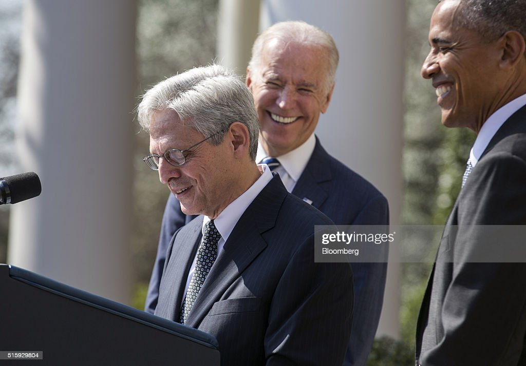 U.S. President Barack Obama, right, and Vice President Joseph 'Joe' Biden, center, laugh during remarks by Merrick Garland, chief judge of the U.S. Court of Appeals for the District of Columbia Circuit, following the announcement of his nomination for the Supreme Court in the Rose Garden of the White House in Washington, D.C., U.S., on Wednesday, March 16, 2016. The nomination escalates a battle that will dominate the final 10 months of Obamas presidency, as the White House is locked in an unprecedented dispute with Senate Republican leaders who have pledged to ignore the presidents choice. Photographer: Joshua Roberts/Bloomberg via Getty Images