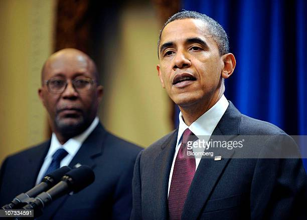 US President Barack Obama right delivers a statement to the media as Ron Kirk US trade representative listens at the Old Executive Office Building in...