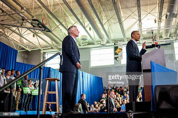 US President Barack Obama right delivers remarks at a Terry McAuliffe campaign event at WashingtonLee High School Arlington Virginia US on Sunday...