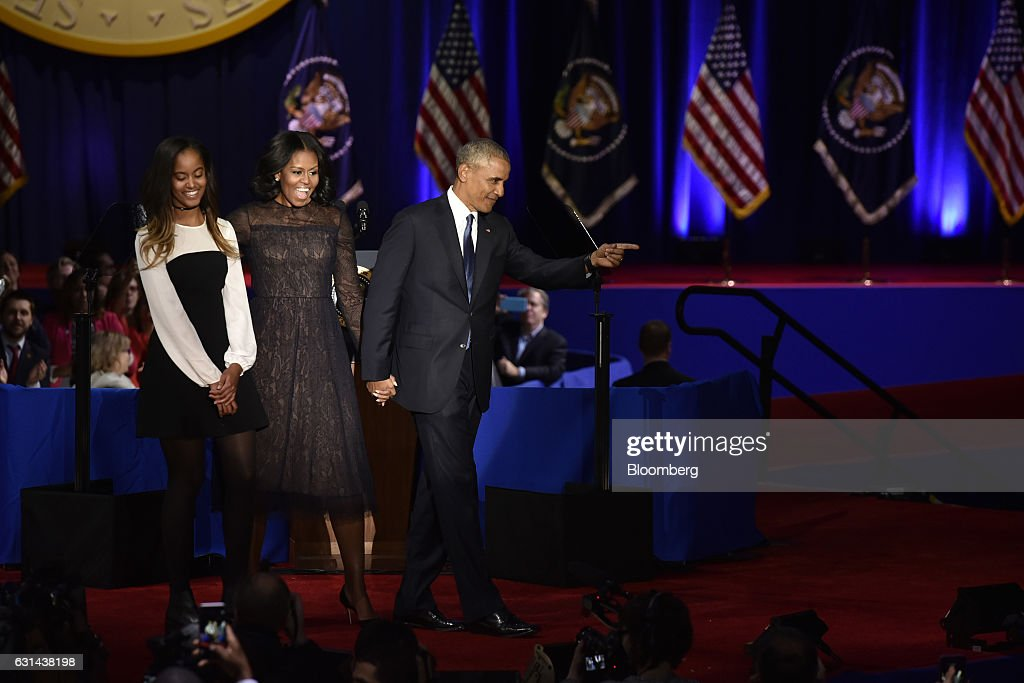 U.S. President Barack Obama, right, gestures as U.S. First Lady Michelle Obama, center, and their daughter Malia Obama look on after his farewell address in Chicago, Illinois, U.S., on Tuesday, Jan. 10, 2017. Obama blasted 'zero-sum' politics as he drew a sharp contrast with his successor in his farewell address Tuesday night, acknowledging that despite his historic election eight years ago his vision for the country will exit the White House with him. Photographer: Christopher Dilts/Bloomberg via Getty Images