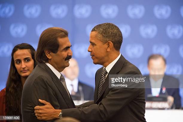 US President Barack Obama right greets Sheik Hamad Bin Khalifa Al Thani emir of Qatar before the Libya Contact Group meeting during the United...