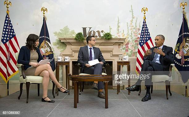 US President Barack Obama right is interviewed by Ezra Klein center and Sarah Kliff left on Vox at the Blair House on January 6 2017 in Washington DC...