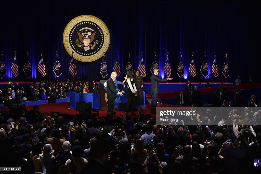 U.S. President Barack Obama, right, is joined on stage by U.S. First Lady Michelle Obama, second right, their daughter Malia Obama, center, U.S. Vice President Joseph 'Joe' Biden, left, and his wife Jill Biden after his farewell address in Chicago, Illinois, U.S., on Tuesday, Jan. 10, 2017. Obama blasted 'zero-sum' politics as he drew a sharp contrast with his successor in his farewell address Tuesday night, acknowledging that despite his historic election eight years ago his vision for the country will exit the White House with him. Photographer: Christopher Dilts/Bloomberg via Getty Images