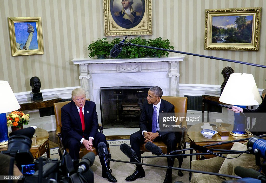 U.S. President Barack Obama, right, listens as U.S. President-elect Donald Trump speaks during a news conference in the Oval Office of the White House in Washington, D.C., U.S., on Thursday, Nov. 10, 2016. Obama on Thursday met face-to-face with Trump, who spent years questioning the eligibility of the first black U.S. president and now will succeed him. Photographer: Pete Marovich/Bloomberg via Getty Images