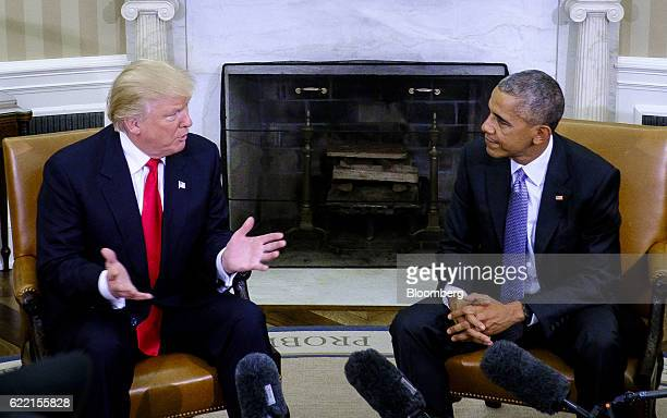 US President Barack Obama right listens as US Presidentelect Donald Trump speaks during a news conference in the Oval Office of the White House in...
