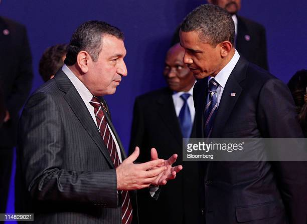 US President Barack Obama right listens to Essam Sharaf Egypt's prime minister left prior to the family photograph during the G8 summit in Deauville...