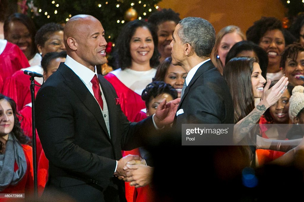 U.S. President Barack Obama, right, shakes hands with Dwayne 'The Rock' Johnson, left, during the taping of TNT's 'Christmas in Washington' program on December 14, 2014 in Washington, DC. Proceeds from the concert will go to Children's National Medical Center.