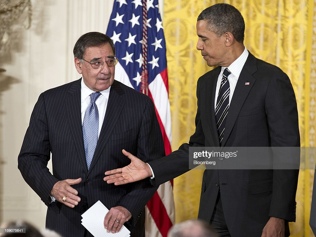 "U.S. President Barack Obama, right, shakes hands with Leon Panetta, U.S. Secretary of Defense, during the announcement of his nominations for Secretary of Defense and director of the Central Intelligence Agency in the East Room of the White House in Washington, D.C., U.S., on Monday, Jan. 7, 2013. ""Chuck Hagel is the leader that our troops deserve,"" Obama said today in an announcement combining his choices of Hagel for the Pentagon and John Brennan to head the Central Intelligence Agency. Photographer: Joshua Roberts/Bloomberg via Getty Images"