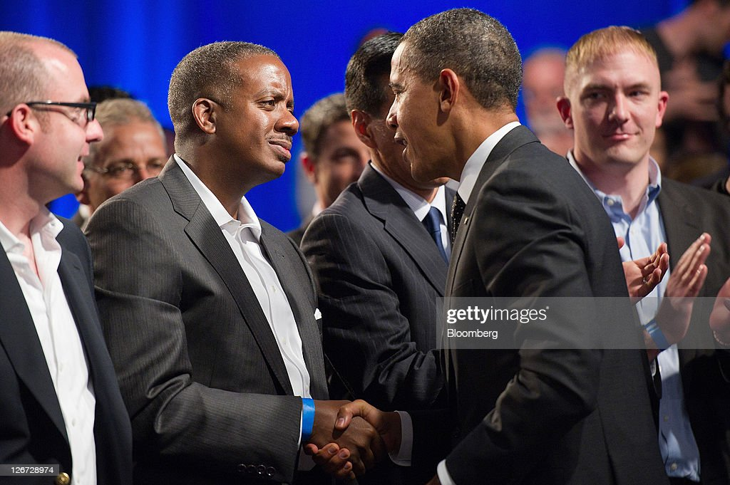 U.S. President Barack Obama, right, shakes hands with Robert Hawley of Charlotte, North Carolina, after a town hall event sponsored by LinkedIn Corp. in Mountain View, California, U.S., on Monday, Sept. 26, 2011. Obama said his $447 billion jobs proposal will give the U.S. economy the 'jump start' it needs to revive job growth. Photographer: David Paul Morris/Bloomberg via Getty Images