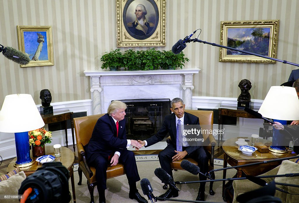 U.S. President Barack Obama, right, shakes hands with U.S. President-elect Donald Trump during a news conference in the Oval Office of the White House in Washington, D.C., U.S., on Thursday, Nov. 10, 2016. Obama on Thursday met face-to-face with Trump, who spent years questioning the eligibility of the first black U.S. president and now will succeed him. Photographer: Pete Marovich/Bloomberg via Getty Images