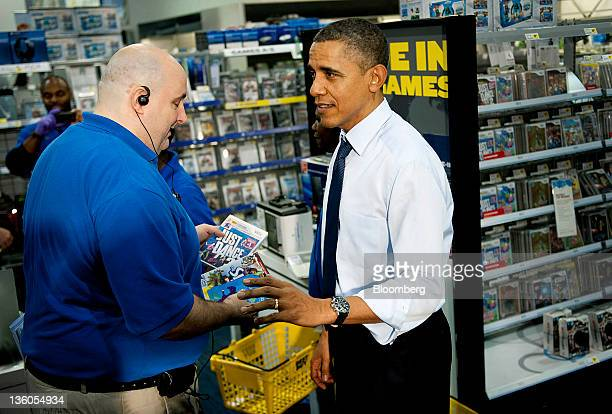 US President Barack Obama right shops for Christmas presents at a Best Buy Co Inc store in Alexandria Virginia US on Wednesday Dec 21 2011 Paychecks...