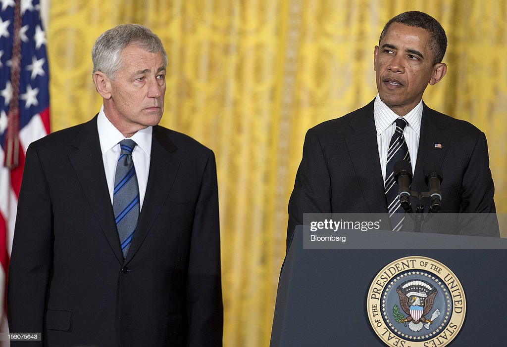 U.S. President Barack Obama, right, speaks as his nominee for Secretary of Defense Chuck Hagel, a former Republican Senator from Nebraska, listens, during the announcement of the nomination in the East Room of the White House in Washington, D.C., U.S., on Monday, Jan. 7, 2013. Obama sees in Chuck Hagel a new Pentagon chief who, as a decorated Vietnam War veteran, can stand up to generals at a tight budgetary time and shares his doubts about open-ended military commitments. Photographer: Joshua Roberts/Bloomberg via Getty Images