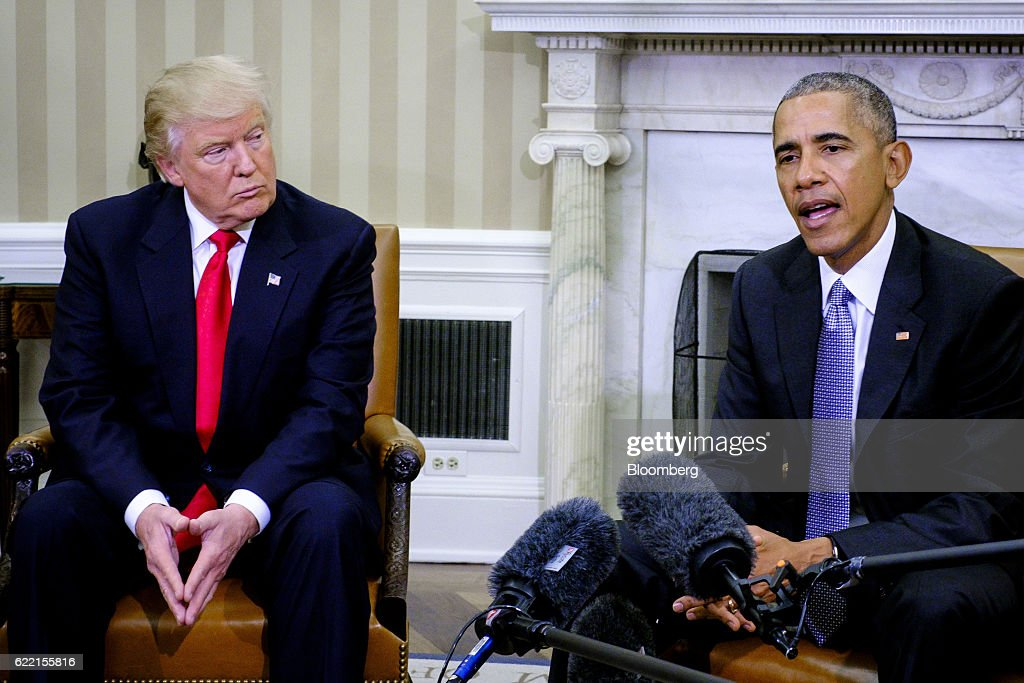 U.S. President Barack Obama, right, speaks as U.S. President-elect Donald Trump listens during a news conference in the Oval Office of the White House in Washington, D.C., U.S., on Thursday, Nov. 10, 2016. Obama on Thursday met face-to-face with Trump, who spent years questioning the eligibility of the first black U.S. president and now will succeed him. Photographer: Pete Marovich/Bloomberg via Getty Images